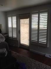 Shutters paired with Woven Wood Shade