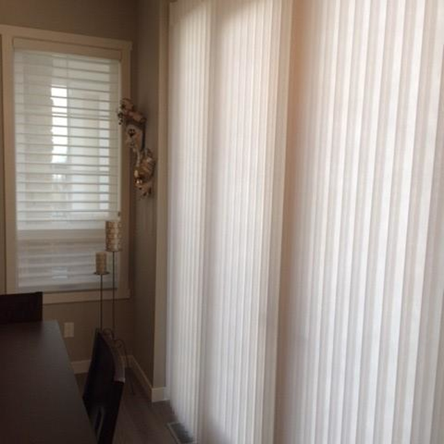 Tall white drapery curtains