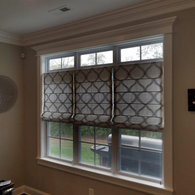 Roman Shades highlight this family's dining area. Our customer chose this beautiful fabric for a rich upscale look.