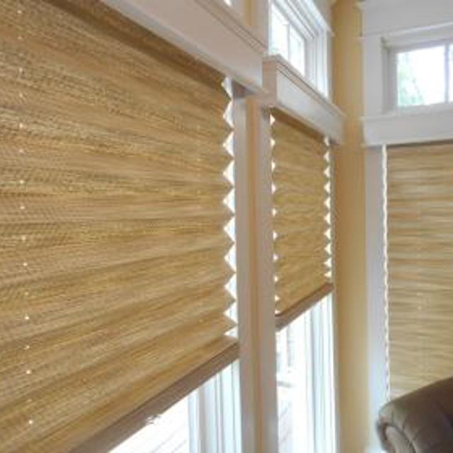 Add texture to your room with beautiful pleated shades. And top the shades with detailed white wood valances.