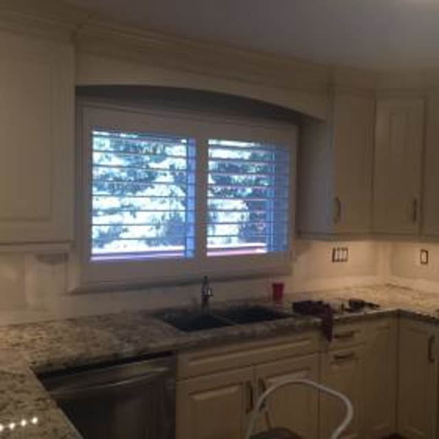 Polyvinyl shutter in kitchen