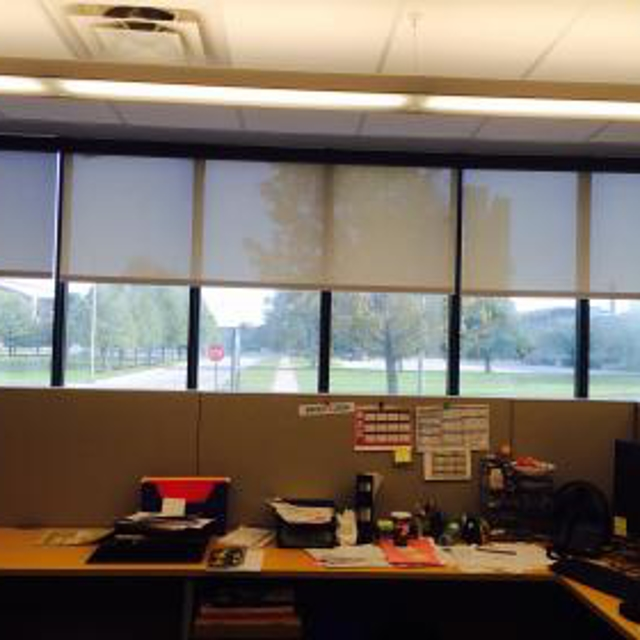 Somfy motorized roller shades that operate individually or as groups with the multi channel remote