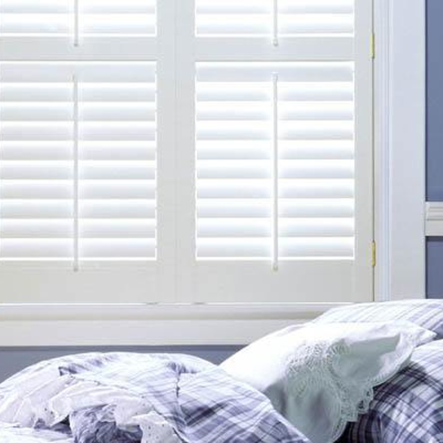 White shutters above bed