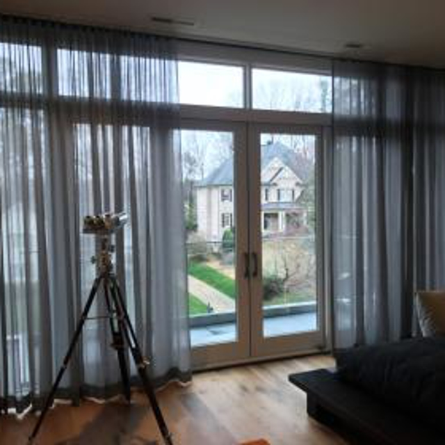 Drapery curtains in living room