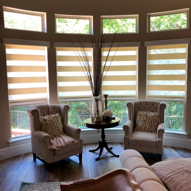 Tan blinds in living room area