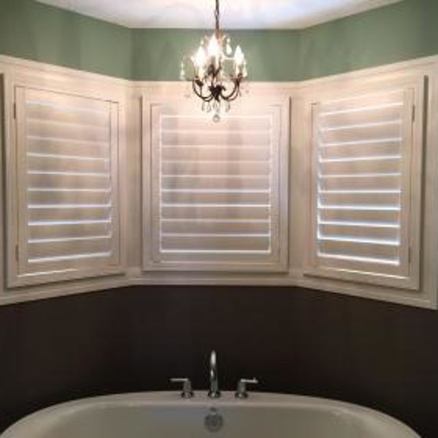 Three white shutters above the master bath