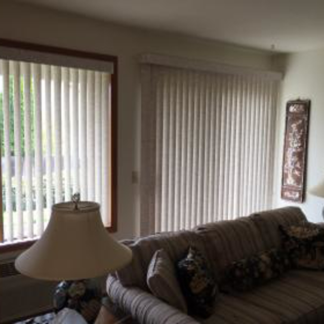 Beautiful new vertical blinds transformed this home. The homeowner is thrilled with how fresh and clean her home feels (the old blinds were 25 years old!), and she has complete control over the amount of light and privacy.