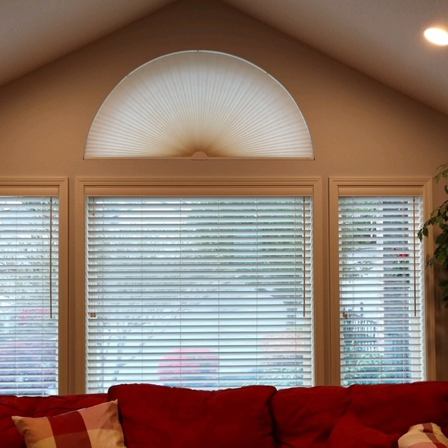 White blinds with fan shade