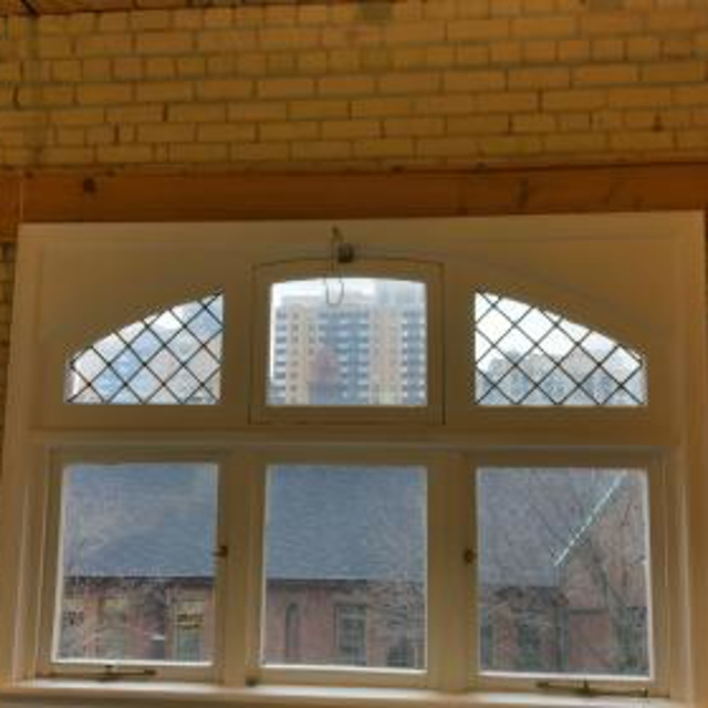 Wanted to reduce heat in this office space and preserve the beauty of this old window.