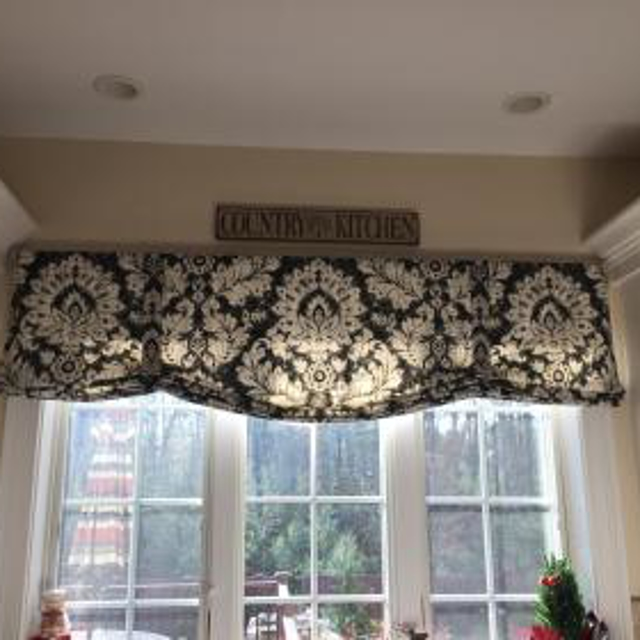 Flat style roman valance looks great on this large kitchen window.