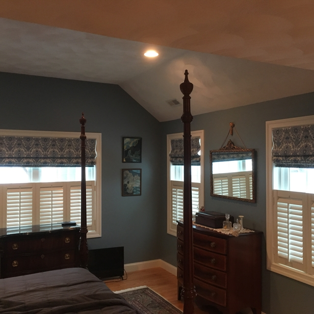 shutters with shades in bedroom