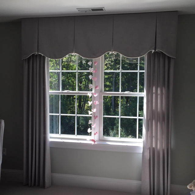 Purple curtains with matching top treatment
