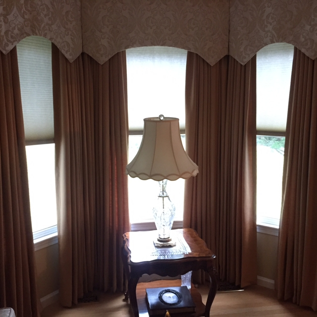 Dark colored drapery curtains in living room
