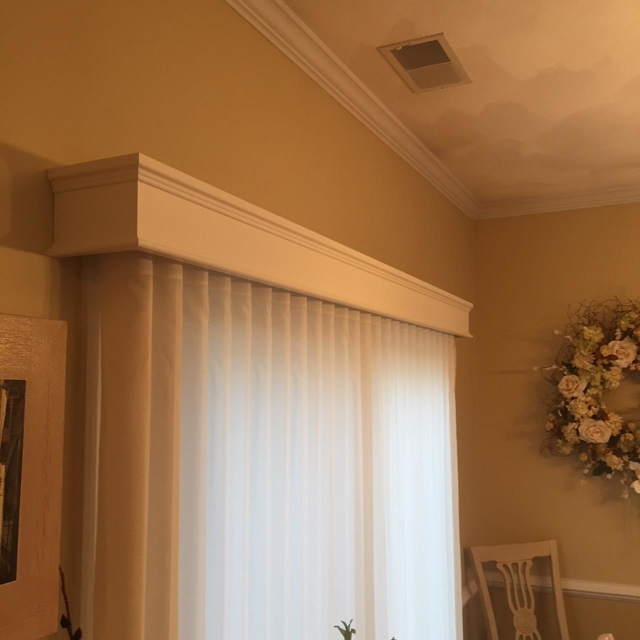 Drapery curtains with a matching top treatment