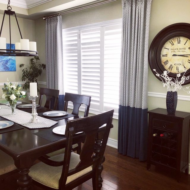 Add texture and cokour to a room with California shutters by adding drapery side panels.