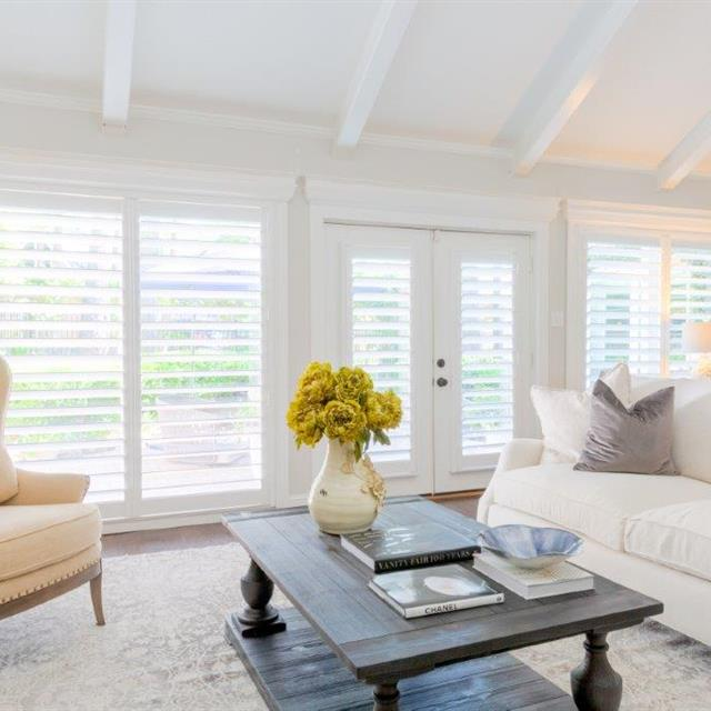 We removed old window treatments and installed new wood shutters for a beautiful 40 year old remodeled home in The Woodlands. The wide panels with hidden tilt bars are a great look which lets in lots of light without obstructing the view.