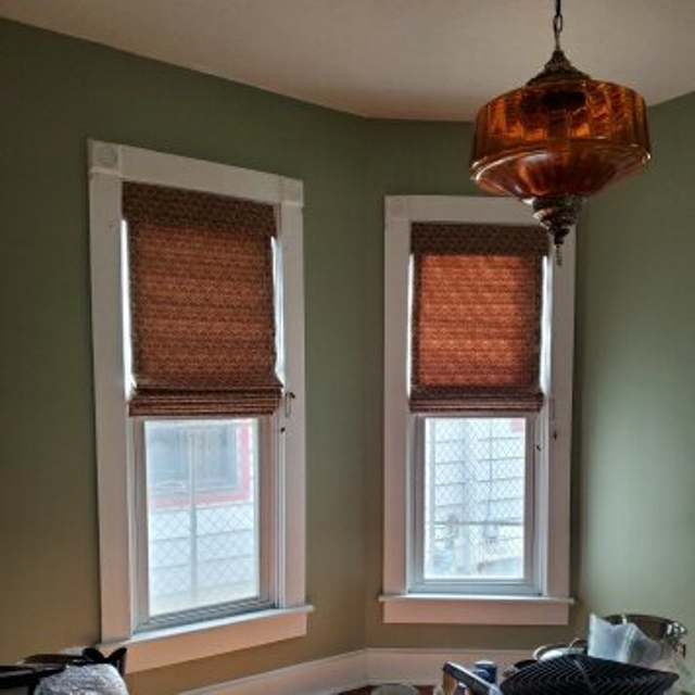 Woven shades over vertical windows