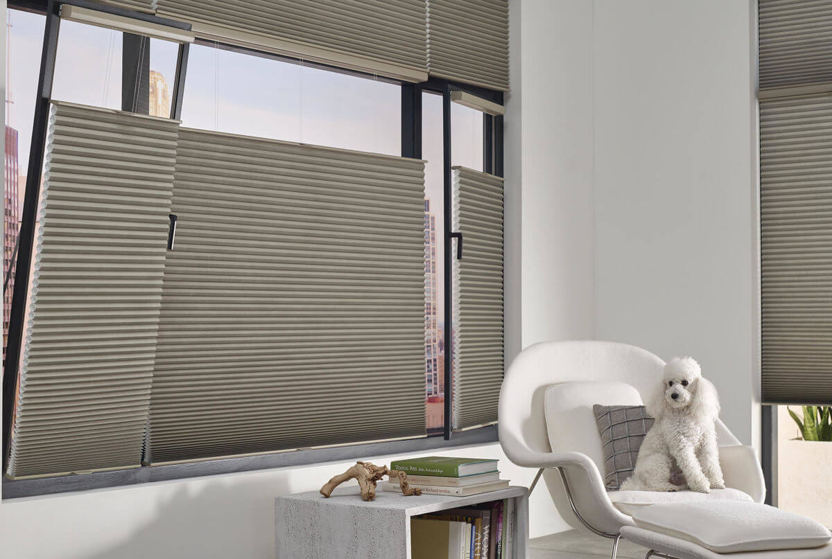 When selecting a window treatment to increase privacy at night, consider cellular shades that have a higher opacity to prevent visibility from the outside.