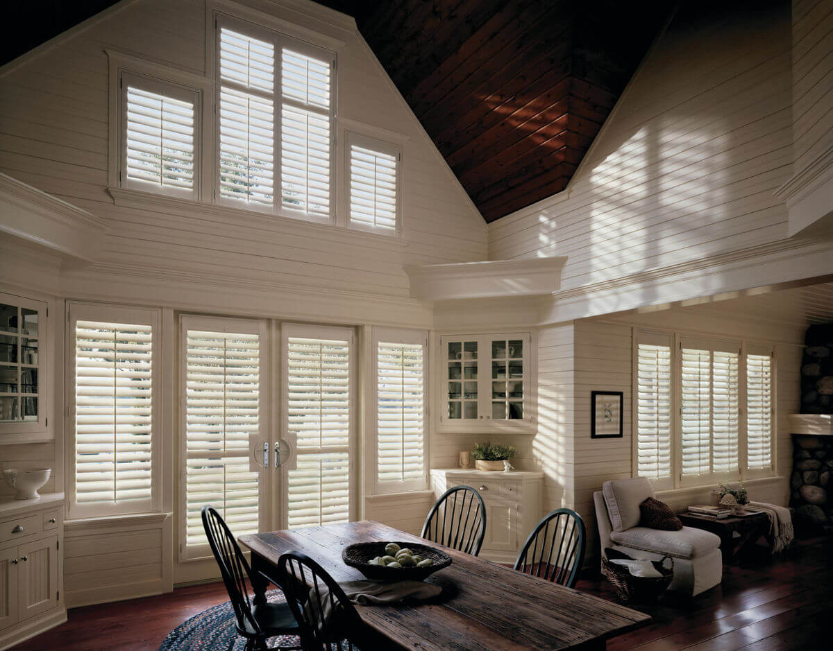Window treatments should reflect a simple charm and character in farmhouse design styles.