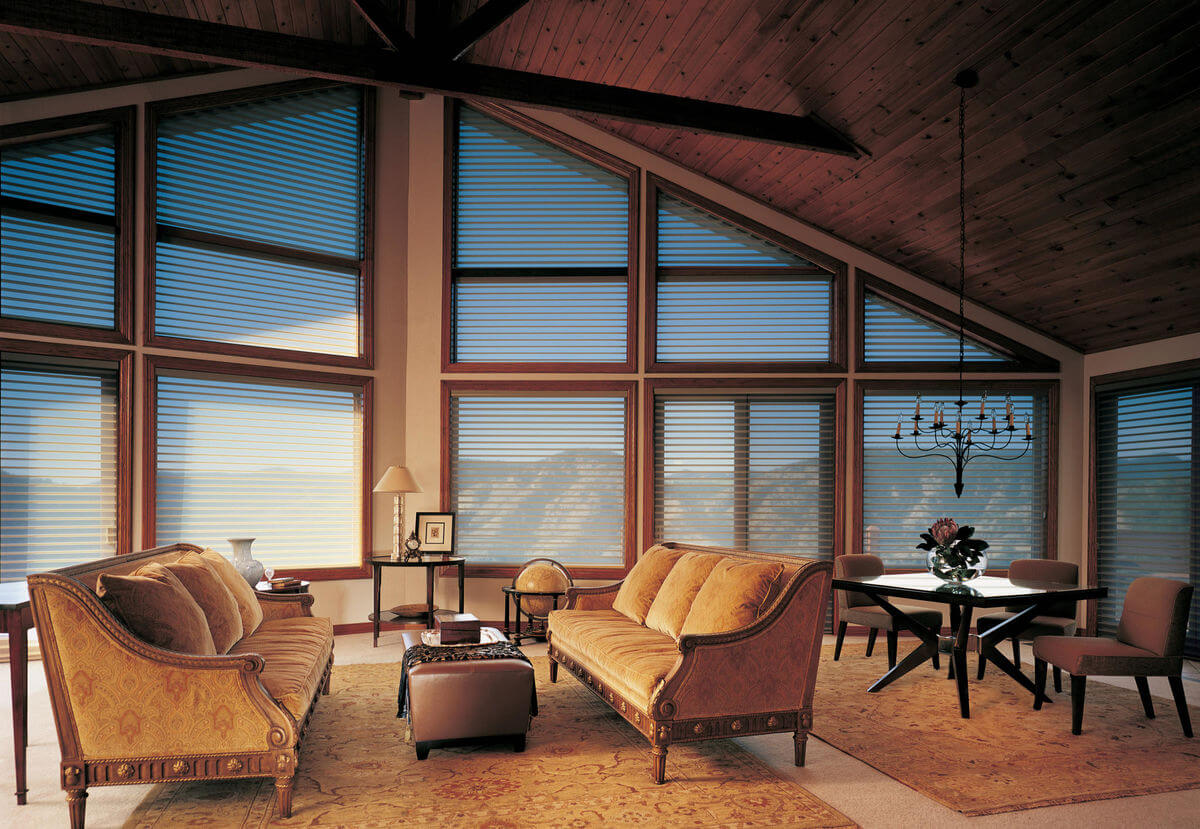 Window treatments for rustic lodge design styles are meant to be functional and fit into the structural design of the space.
