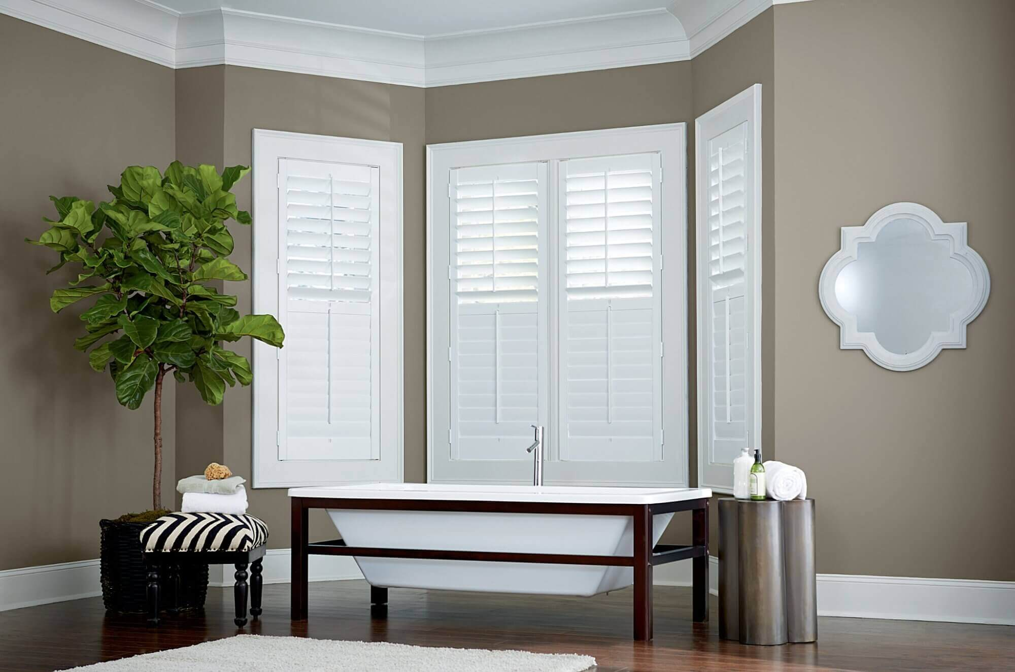 Bathroom window treatments need to allow in light while still providing a certain level of privacy.
