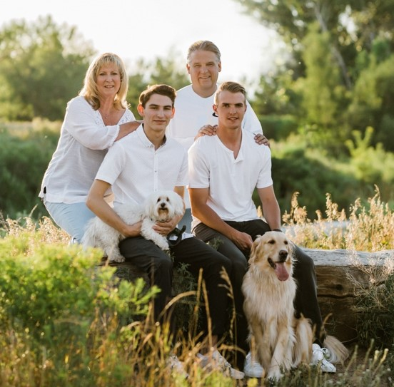 Susan with her husband, 2 sons & 2 dogs